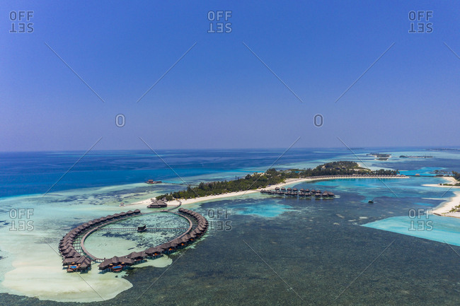 Aerial view over Olhuveli with water bungalows- South Male Atoll- Maldives