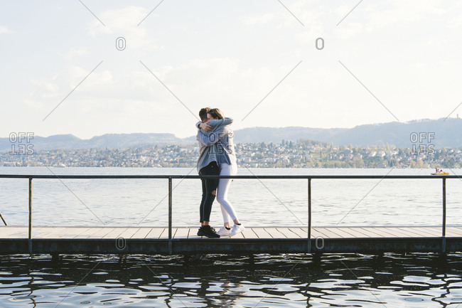 Young couple hugging each other on jetty at Lake Zurich- Zurich- Switzerland