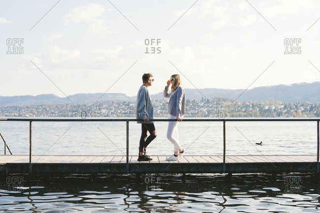 Young couple standing on jetty at Lake Zurich- Zurich- Switzerland