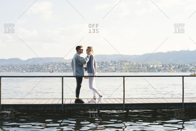 Young couple in love standing on jetty at Lake Zurich- Zurich- Switzerland