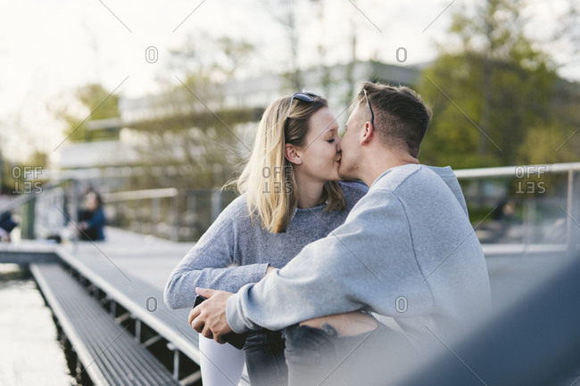 Young couple kissing on jetty at Lake Zurich- Zurich- Switzerland