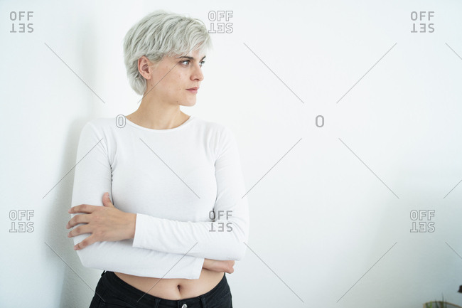 Woman with dyed hair looking sideways