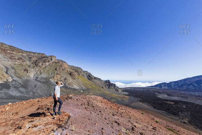 Tourist enjoying view from Sliding Sands Trail- Haleakala volcano- Haleakala National Park- Maui- Hawaii- USA