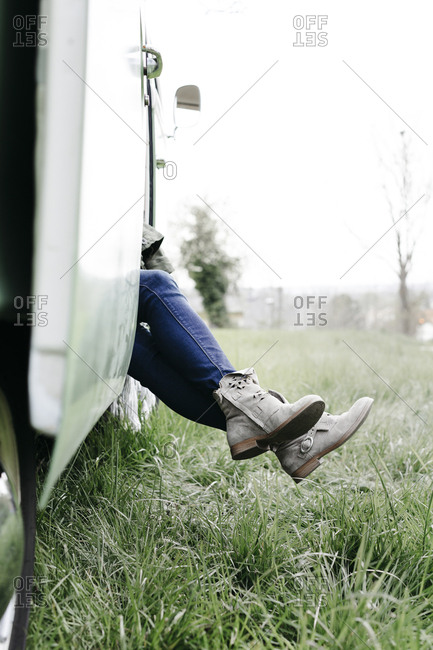 Legs of woman- sitting in a camper