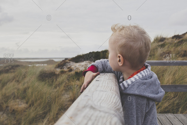 Blond little boy looking at the dunes- Sylt- Germany