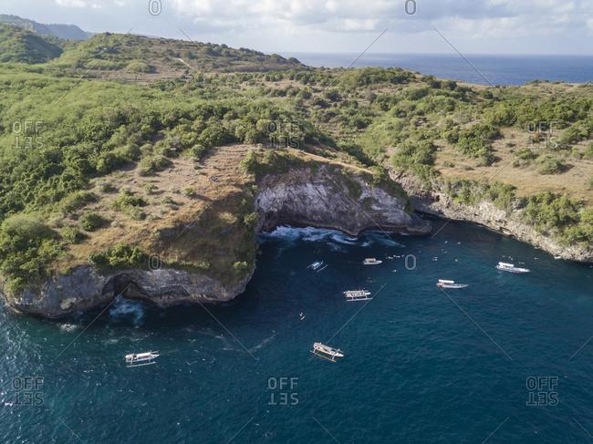 Aerial view of tourist boats at Manta bay- snorkeling tour-Nusa Penida- Bali- Indonesia