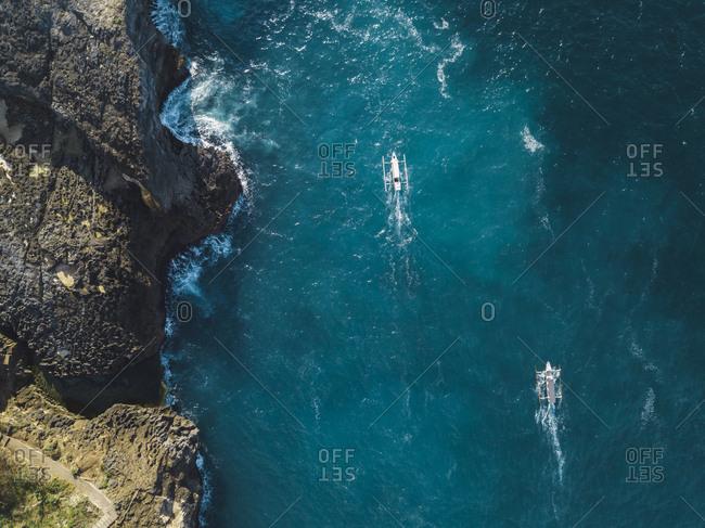 Aerial view of tourist boats near Nusa Penida coastline- snorkeling tour- Bali- Indonesia