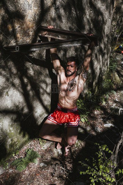 Young man doing workout in nature