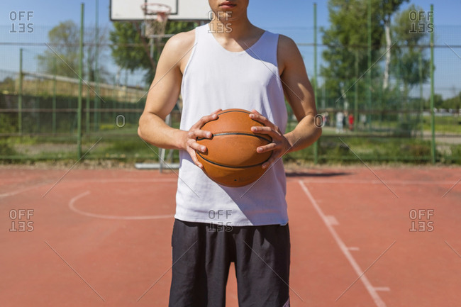 Young man holding basketball
