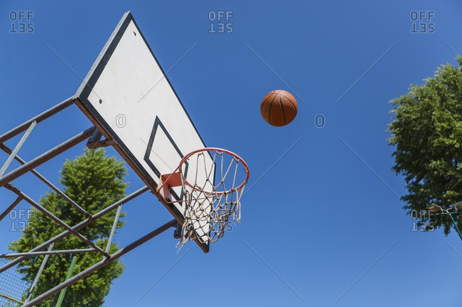 Basketball and hoop- blue sky