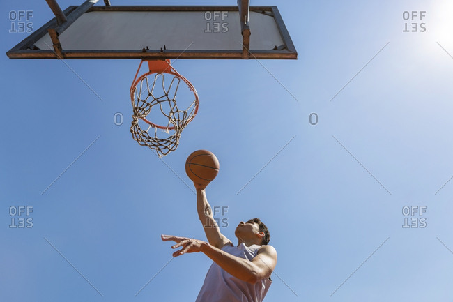 Young man throwing the basketball