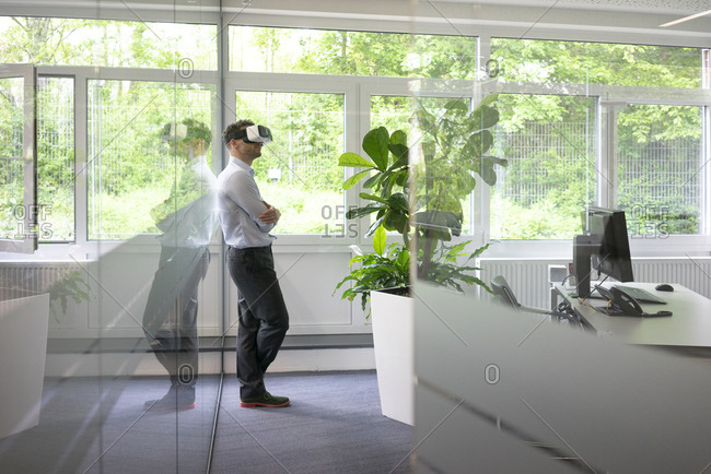 Businessman wearing VR glasses in office