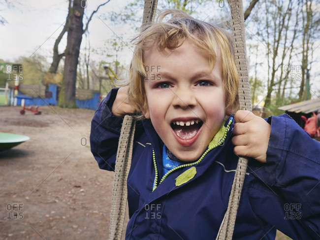 Portrait of screaming little boy on playground
