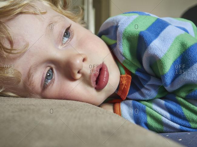 Portrait of lying little boy