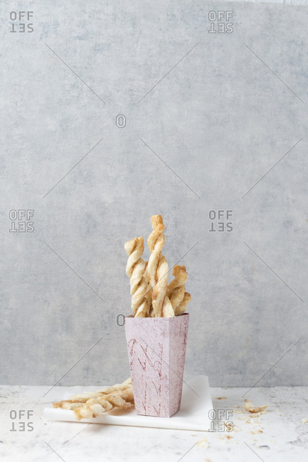 Paperbag of puff pastry sticks with sugar and cinnamon