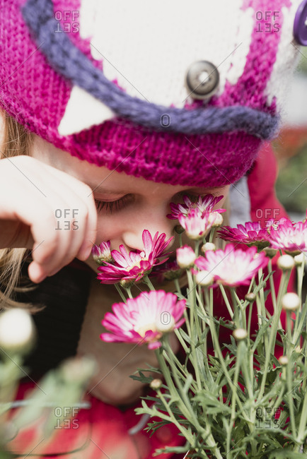 Close-up of girl smelling at flowers