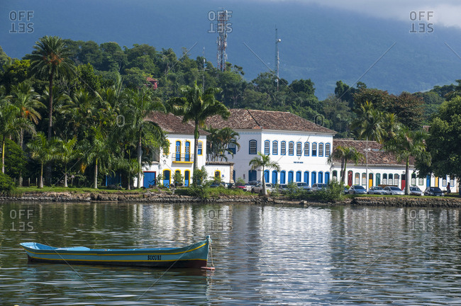 Boat anchored before colourful colonial house in Paraty- south of Rio de Janeiro- Brazil