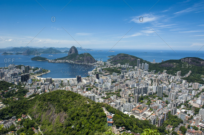 Outlook from the Christ the Redeemer statue over Rio de Janeiro with Sugarloaf Mountain- Brazil