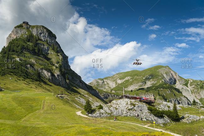 Austria- Tyrol- Maurach- Rofan Mountains- cable car- Airrofan Skyglider over flower meadow