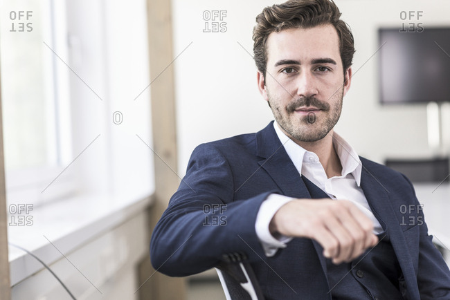 Portrait of a young businessman in office