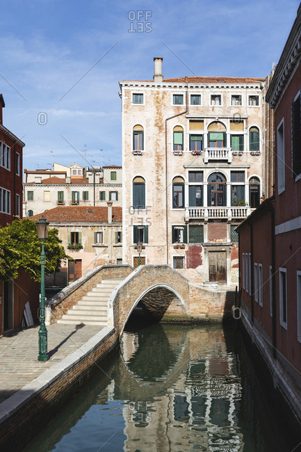 City view with canal- footbridge and typical buildings- Venice- Italy