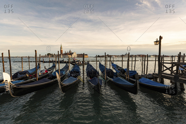 View to San Giorgio Maggiore with row of gondolas in the foreground in the evening- Venice- Italy
