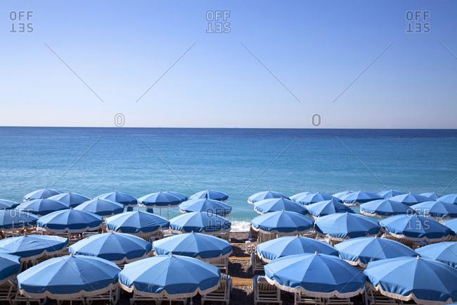 Nice, France - January 27, 2010: Beach umbrellas for rent on the Mediterranean sea