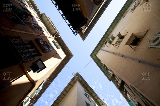 View of old apartments and clouds in the sky forming an X, Nice, France