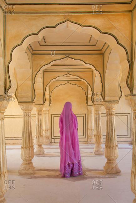 Hindu lady wearing a sari at Amber fort, Jaipur, India