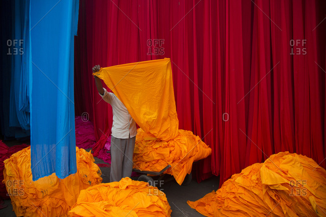 Cloth dying factory with cloths in various prime colors drying, Jaipur, India