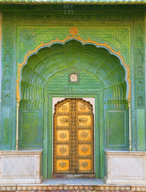 Ornate green entrance door to The City Palace complex, Jaipur, India