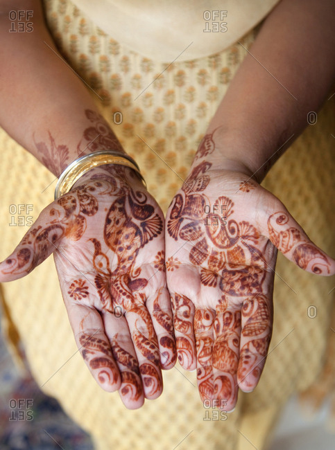 Close up of lady's Henna decorated hands in New Delhi, India