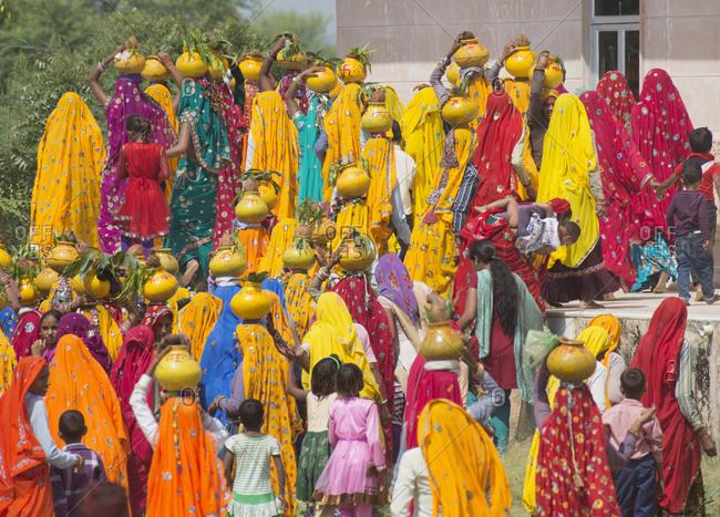 Agra, India - October 8, 2013: Hindu women walking to temple for prayers celebrating Krishna Hindu God