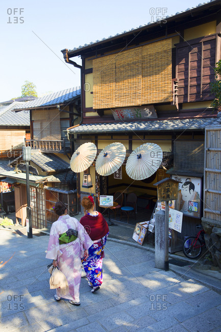 Kyoto, Japan - November 29, 2015: Japanese women in traditional clothing near shops in the Kiyomizudera district