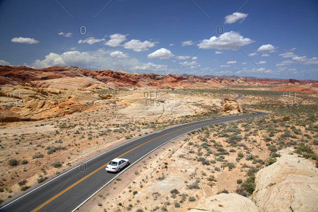 Car driving park roadway in the desert, Valley of Fire State Park, Nevada, USA