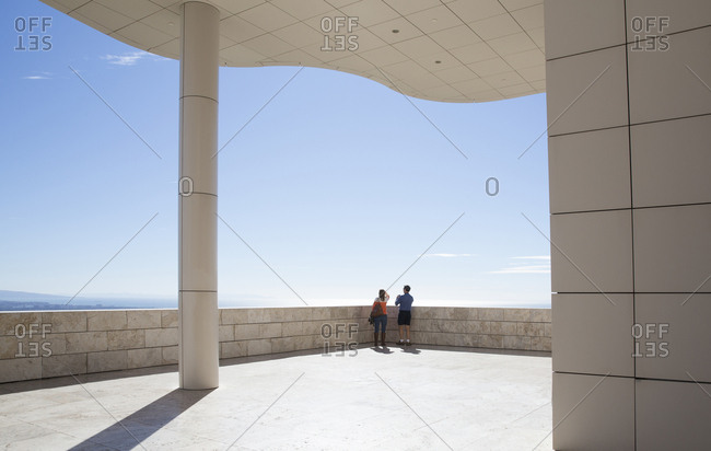 Los Angeles, California - February 2, 2016: Young couple looking out at the view from The Getty Museum