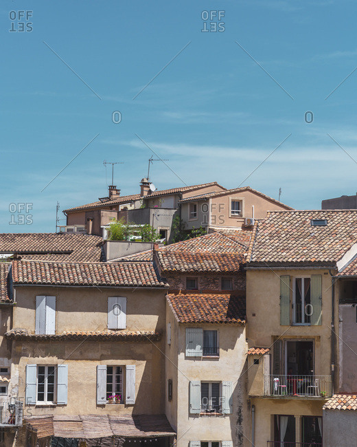 Europe - July 3, 2019: Exterior of old hillside homes with terracotta rooftops