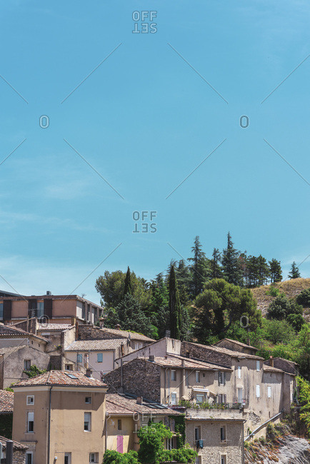 Europe - July 3, 2019: Old hillside homes with terracotta rooftops
