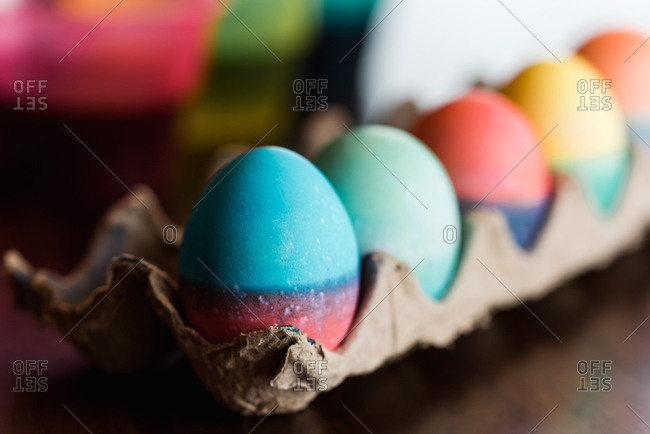 Close up of dyed Easter eggs in bright colors drying in a carton.