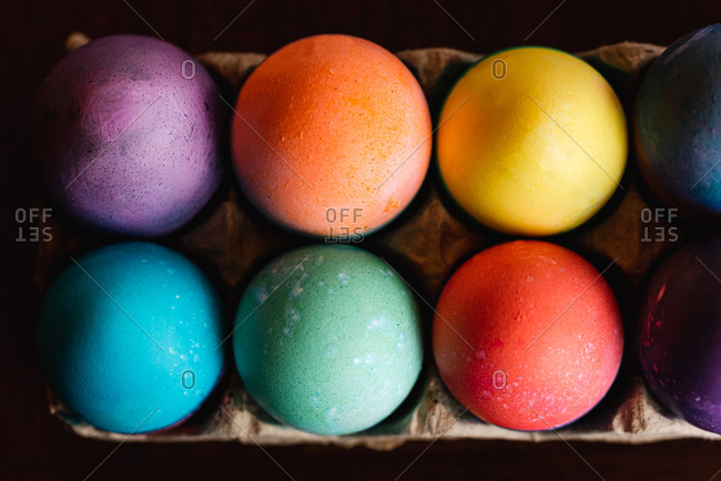 High angle close up of brightly colored Easter eggs.