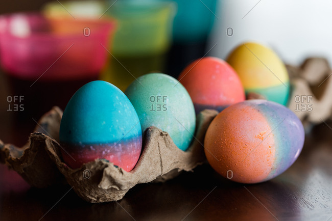 Close up of dyed Easter eggs in bright colors drying  on a carton.