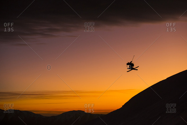 Person Performing A Jump While Skiing