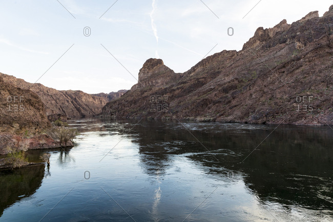 Calm river flowing through rocky canyon