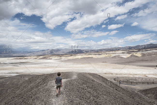 Rear view of boy hiking at Harmony Borax Works in Death Valley National Park, California, USA