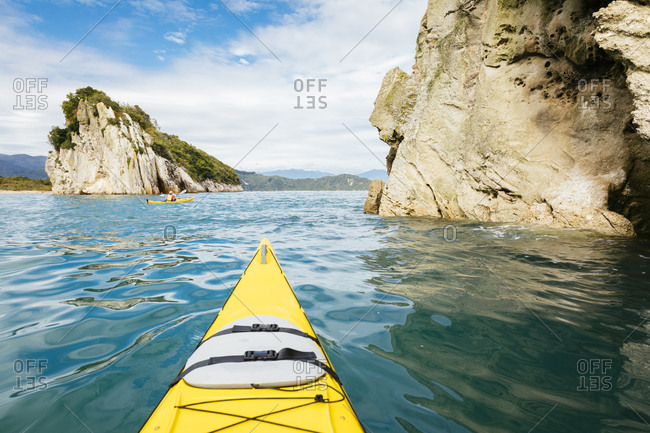 Point of view of person kayaking beside Abel Tasman National Park cliffs