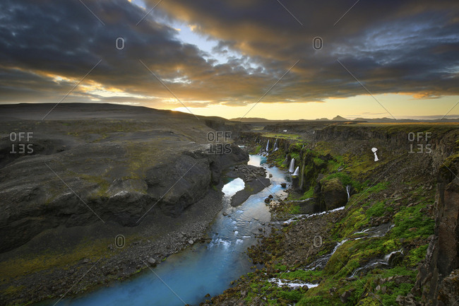 River running through Sigoldugljufur Canyon Highlands at sunset, Iceland