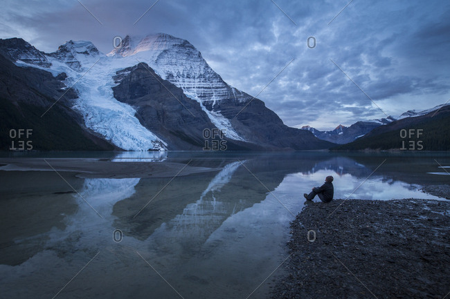 A man in front of a lake, Mount Robson Provincial Park, British Columbia, Canada