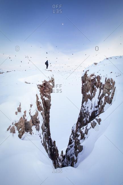 Man on snowy cliffs - Offset