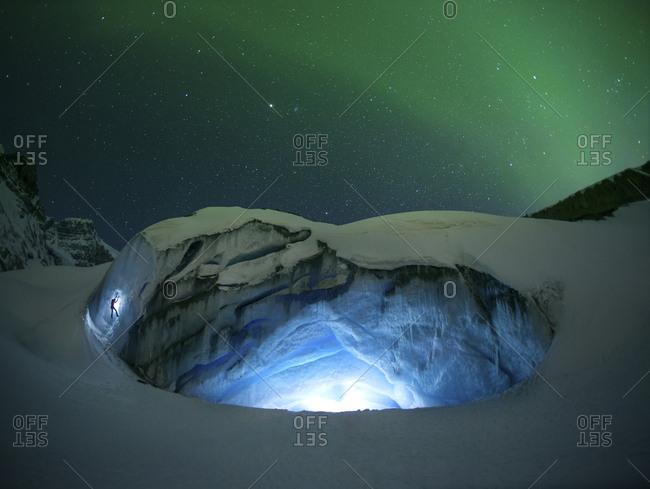 Ice climbing under aurora - Offset