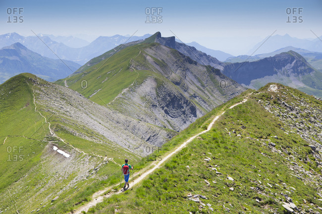 A hiker on the summit ridge of Mont Jolly, a mountain on the Tour du Mont Blanc.